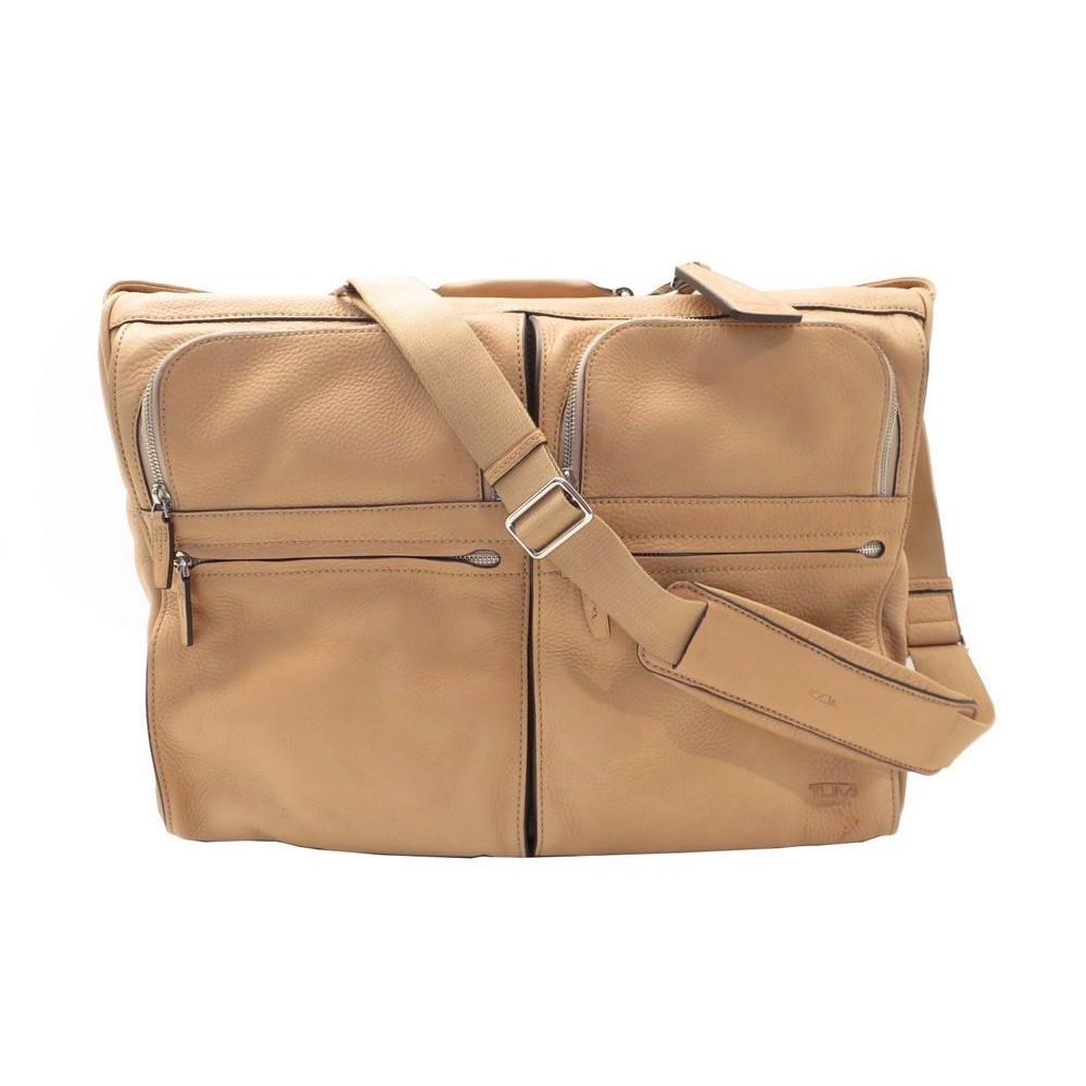 sac de voyage a main tumi housse a vetements en cuir. Black Bedroom Furniture Sets. Home Design Ideas