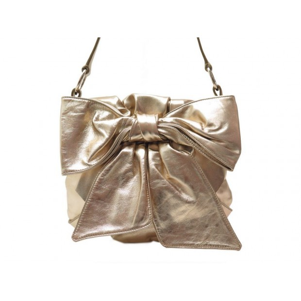 NEUF SAC A MAIN YVES SAINT LAURENT BOW 151216 EN CUIR DORE NOEUD GOLD PURSE 800€