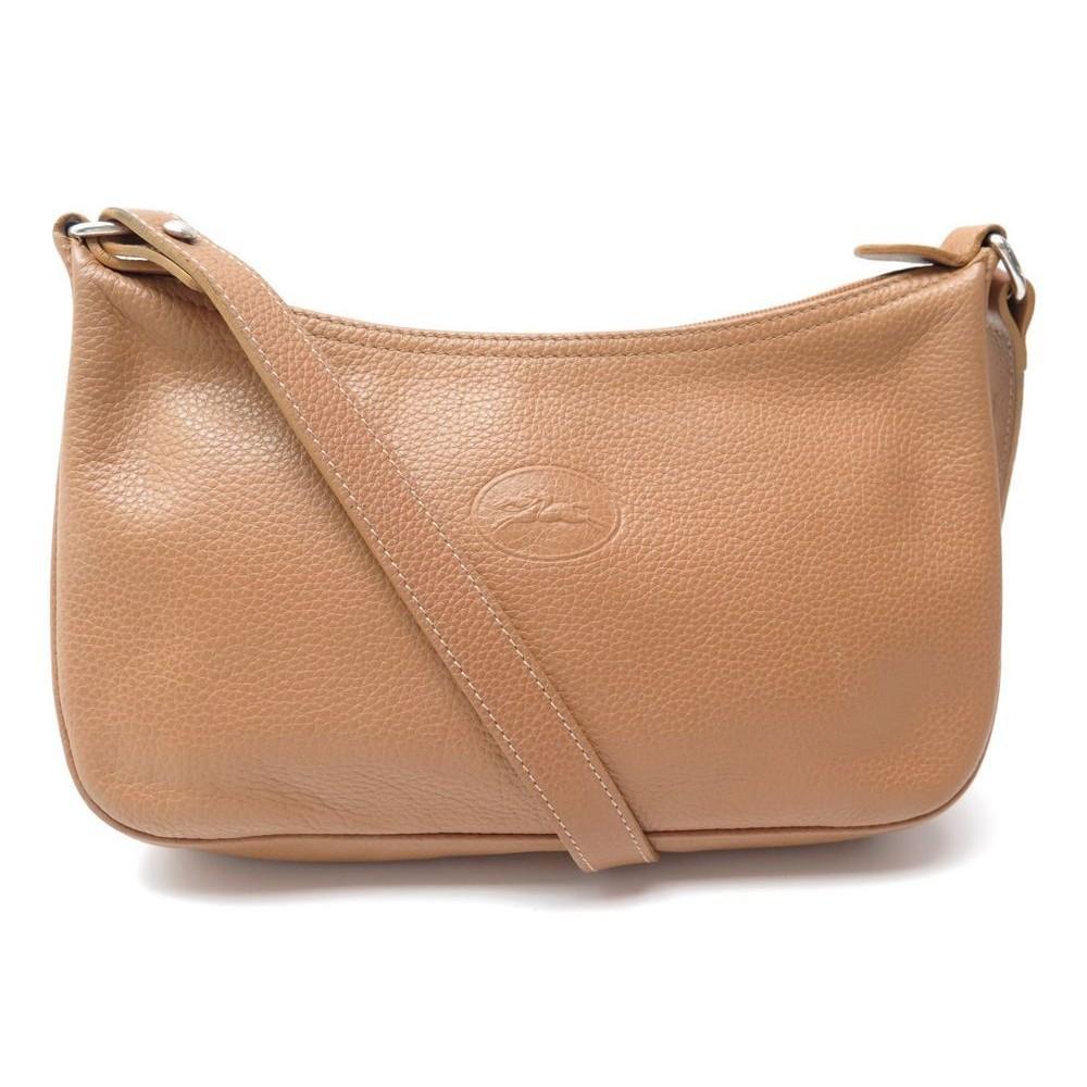 sac a main longchamp pochette bandouliere cuir graine