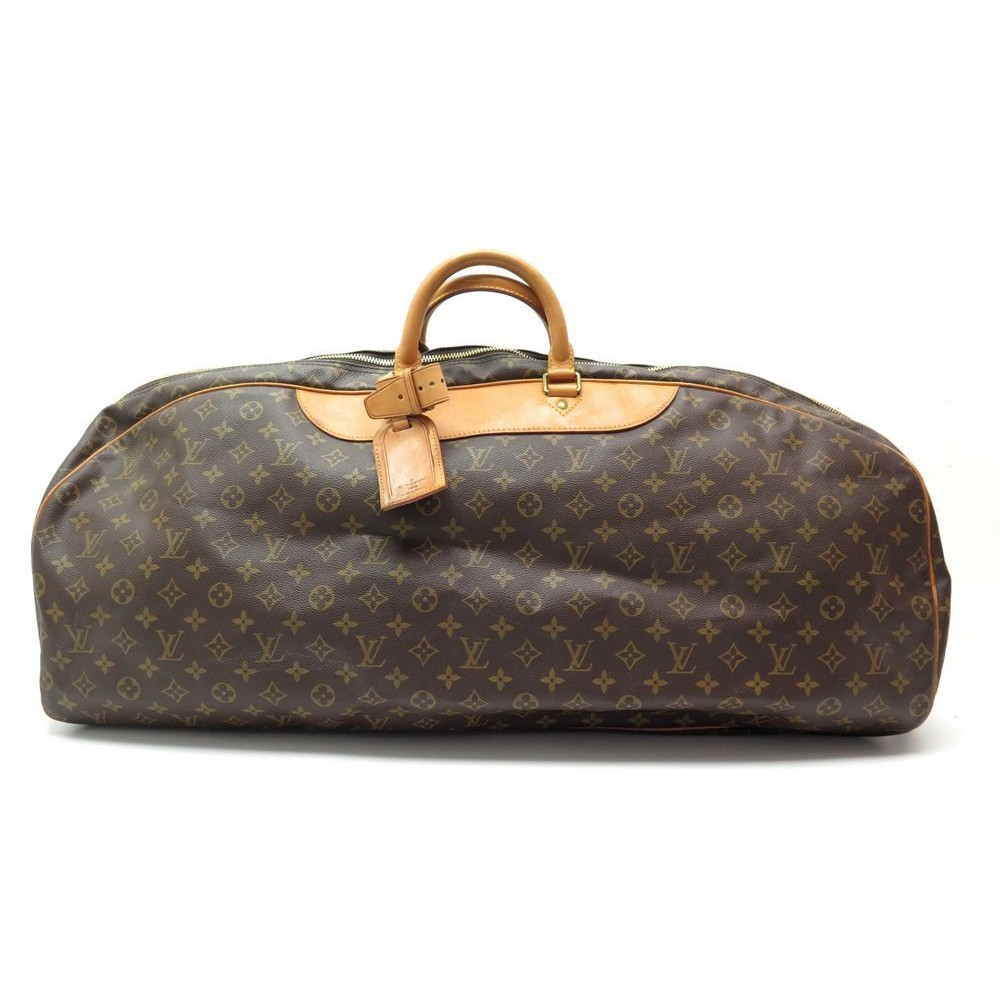 2f1a2e662c6 SAC DE SPORT A MAIN LOUIS VUITTON TENNIS MONOGRAM VOYAGE. Loading zoom